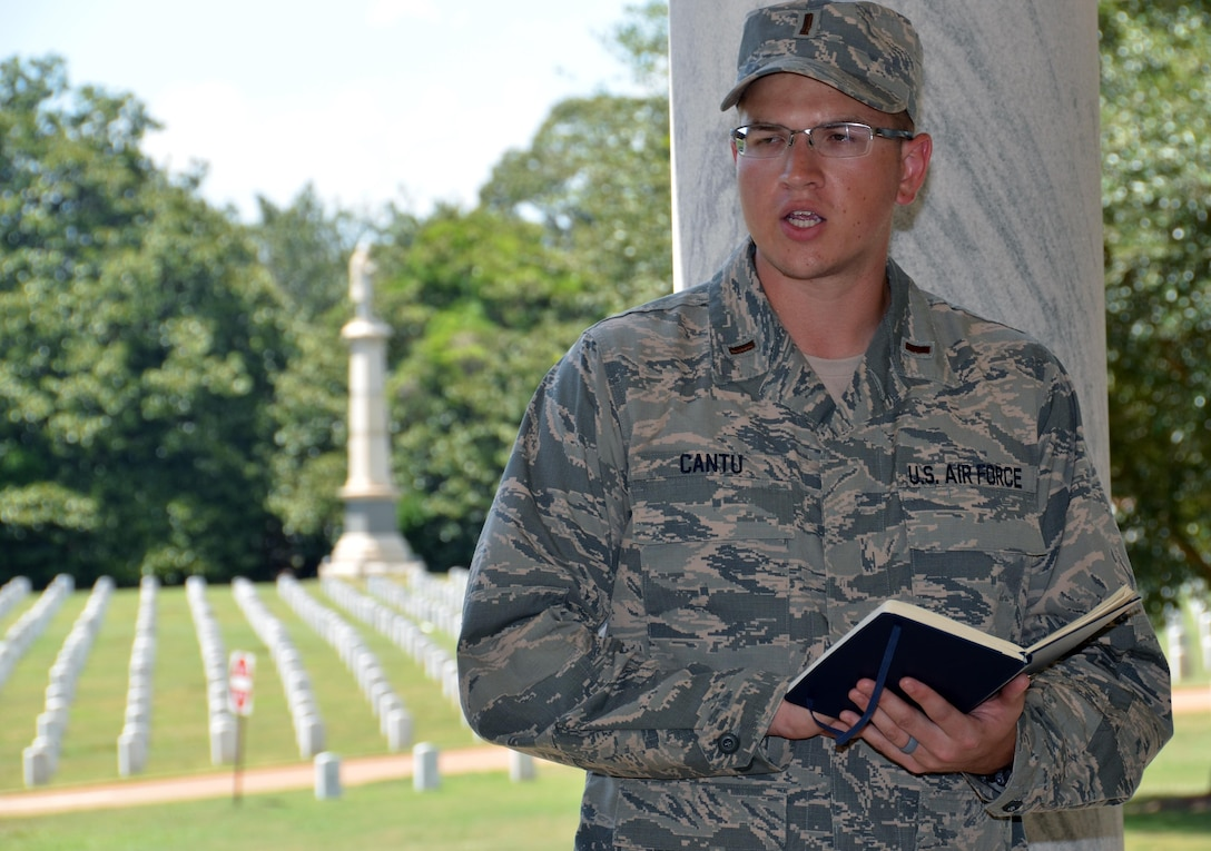 Chaplain candidate 2nd Lt. Nathaniel Cantu reads scripture to an audience during a memorial service held at Andersonville National Cemetery, Andersonville, Ga, July 27. The candidates are participatants in the Air Force Reserve Command Chaplain Candidate Intensive Interview program which aims to provide an extensive overview of what the Air Force Reserve mission is as well as a broad overview of the military chaplain corps.(U.S. Air Force photo/Tech. Sgt. Kelly Goonan)