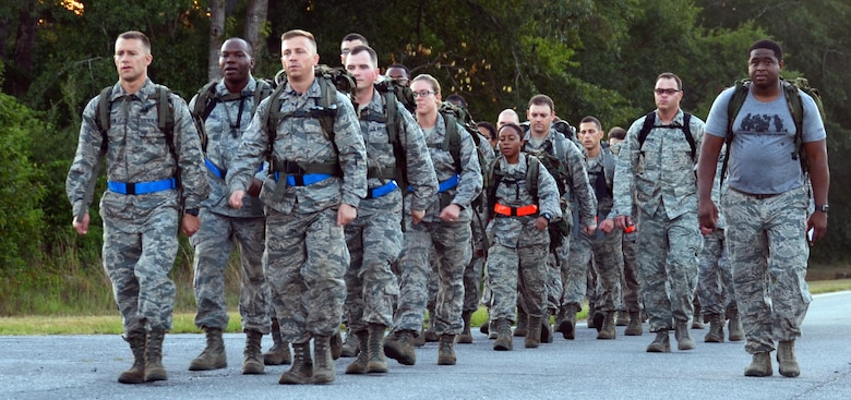 2nd Lt. Caleb Walker and 2nd Lt. David Edwards, chaplain candidates, lead the rest of the candidates on a 2.8 mile ruck march while Chaplain (Maj.) Stacey Hanson, 94th Airlift Wing, and an Instructor from the 5th Combat Communications Squadron Support, march along side them at Robins Air Force Base, Georgia, July 25. The candidates are participants in the Air Force Reserve Command Chaplain Candidate Intensive Interview program which aims to provide an extensive overview of the Air Force Reserve mission and military chaplain corps.(U.S. Air Force photo/Tech. Sgt. Kelly Goonan)