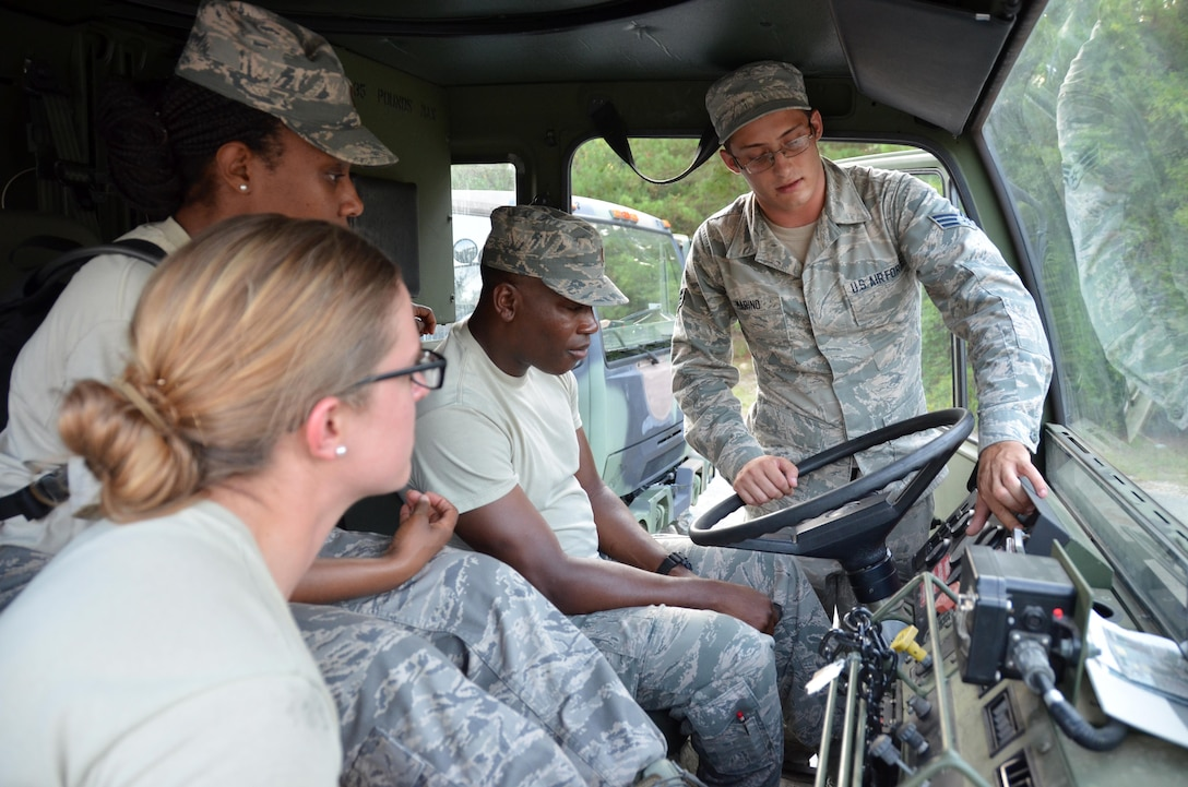 Instructor SrA. Duke Marino, 5th Combat Communications Squadron Support, explains how to drive the M1078 Light Medium Tactical Vehicle to 2nd Lt. Willy Gedeon, 2nd Lt. Meagan Davis and 2nd Lt. at Robins Air Force Base, Georgia, July 25, 2016. The candidates are participants in the Air Force Reserve Command Chaplain Candidate Intensive Interview program which aims to provide an extensive overview of what the Air Force Reserve mission is as well as a broad overview of the military chaplain corps.(U.S. Air Force photo/Tech. Sgt. Kelly Goonan)