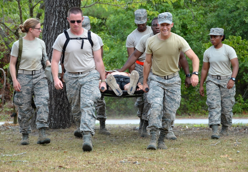"Chaplain candidates 2nd Lt. Kara Dula, 2nd Lt. Seth Duhs, 2nd Lt. Tyler Brown, 2nd Lt. Caleb Walker, and 2nd Lt. Jasmin Luck, work together to hoist and carry a casualty to a safe location at Robins Air Force Base, Georgia, July 25, 2016. The candidates had just completed self-aid buddy care classroom instruction when they were rushed outside to put their new knowledge to the test when an ""attack"" happened outside, resulting in casualties. The candidates are participants in the Air Force Reserve Command Chaplain Candidate Intensive Interview program which aims to provide an extensive overview of what the Air Force Reserve mission is as well as a broad overview of the military chaplain corps.(U.S. Air Force photo/Tech. Sgt. Kelly Goonan)"