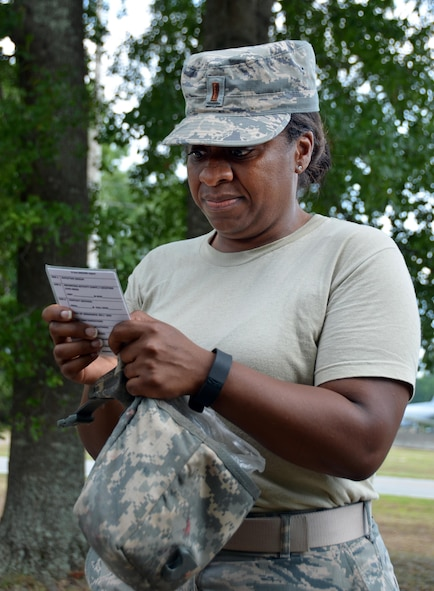 "2nd Lieutenant Tiesha Simmons, Chaplain Candidate, reads through the 9 Line information as she calls for a medical evacuation during a training scenario with ""wounded"" civilians at Robins Air Force Base, Georgia, July 25, 2016. The candidates had just completed self-aid buddy care classroom instruction when they were rushed outside to put their new knowledge to the test when an ""attack"" happened outside, resulting in casualties. During the last week of the Air Force Reserve Command Chaplain Candidate Intensive Interview program, twenty-five candidates were immersed in fast-paced mobility training conducted by active-duty instructors from the 5th CBCSS. This mobility training, typically a two-week process, was condensed and compacted to fit into the two-day window the candidates had available. They received instruction on self-aid and buddy care, land navigation, and participated in mock scenarios that were aimed to prepare them for what they could possibly see in a deployed environment."