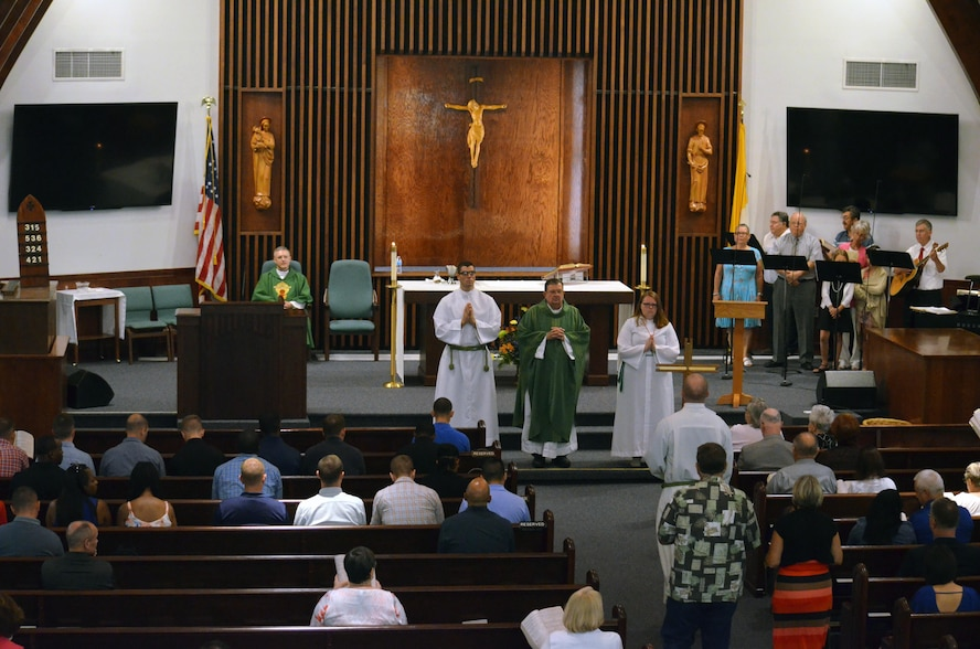 Chaplain candidates and members of the Catholic church attend Sunday morning worship in the base chapel at Robins Air Force Base, Georgia, July 25, 2016. The candidates are participating in the Air Force Reserve Command Chaplain Candidate Intensive Interview program which aims to provide an extensive overview of what the Air Force Reserve mission is as well as a broad overview of the military chaplain corps. During the last week of the AFRC program, the candidates were immersed in fast-paced mobility training conducted by active-duty instructors from the 5th Combat Communications Squadron Support. (U.S. Air Force photo/Tech. Sgt. Kelly Goonan)