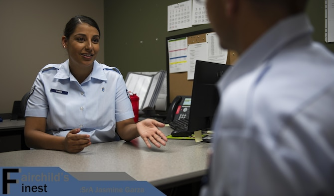 Senior Airman Jasmine Garza, 92nd Medical Operations Squadron mental health technician, talks with a patient July 29, 2016 at Fairchild Air Force Base, Wash. Her leadership selected her as one of Fairchild's Finest, a weekly recognition program that highlights top-performing Airmen. (U.S. Air Force photo/Airman 1st Sean Campbell)