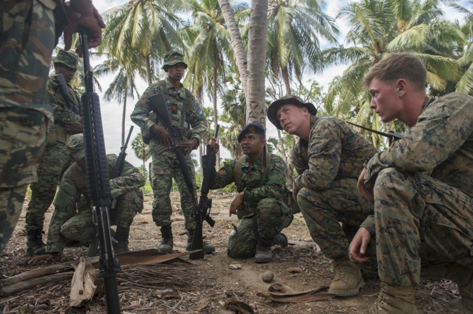 U.S. Marine Sgt. Christopher Krieg, assigned to Fleet Anti-terrorism Security Team Pacific, listens to a question from a Forsa Defesa Timor-Leste (F-FDTL) service member while discussing convoy ambushes during Cooperation Afloat Readiness and Training (CARAT) Timor-Leste 2016. The focus of CARAT is developing maritime security capabilities and increasing interoperability among participants. Skill areas exercised during CARAT include Maritime Interdiction Operations; riverine, amphibious and undersea warfare operations; diving and salvage operations; naval gunnery and maneuvering events, along with disaster response exercises.