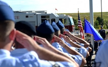 Members of the 460th Mission Support Group salute the American flag August 1, 2016, during the MSG change of command on Buckley Air Force Base, Colo. A change of command ceremony represents the formal transfer of responsibility from an outgoing commander to their successor. (U.S. Air Force photo by Airman 1st Class Gabrielle Spradling/Released)