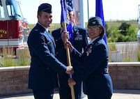 Col. Rose Jourdan, former 460th Mission Support Group commander, relinquishes the MSG guide-on to Col. John Wagner, 460th Space Wing commander, August 1, 2016, during the MSG change of command on Buckley Air Force Base, Colo. The outgoing commander passes the guide-on to the incoming commander to symbolize that the group will never be without a leader. (U.S. Air Force photo by Airman 1st Class Gabrielle Spradling/Released)
