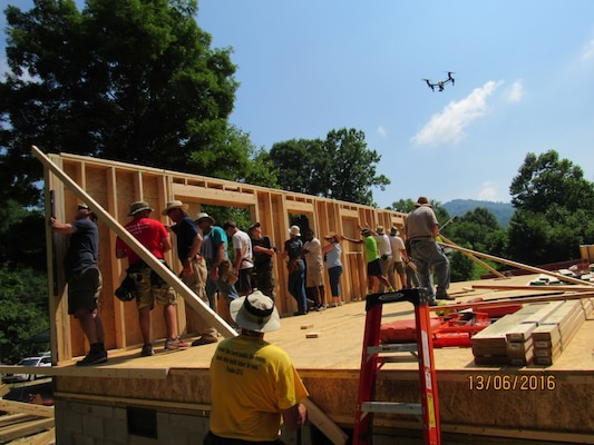 The Mountain Outreach team builds a home for a family in need.