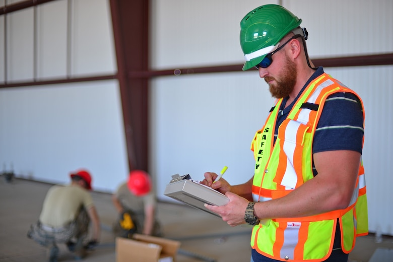 Jason Webb, 341st Missile Wing occupational safety and health specialist, writes notes Aug. 1, 2016, at Malmstrom Air Force Base, Mont. The safety office reaches out to the base in different ways to help educate individuals on improving personal or workplace procedures. (U.S. Air Force photo/Airman 1st Class Daniel Brosam)