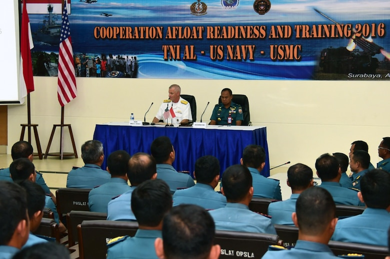 Rear Adm. Brian Hurley, Commander, Logistics Group Western Pacific, and 1st Adm. Mintoro Yulianto, Indonesian Navy (TNI-AL) Eastern Fleet Chief of Staff, preside over the opening ceremony of Cooperation Afloat Readiness and Training (CARAT) Indonesia 2016.  CARAT is a series of annual maritime exercises between the U.S. Navy, U.S. Marine Corps and the armed forces of nine partner nations to include Bangladesh, Brunei, Cambodia, Indonesia, Malaysia, the Philippines, Singapore, Thailand, and Timor-Leste.