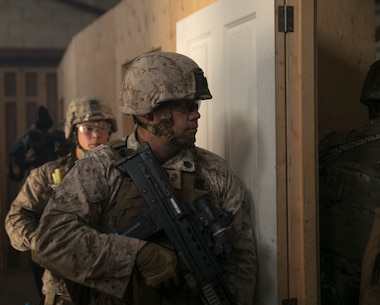 Staff Sgt. Eric McLeish, Marine Corps Security Battalion Bangor, Washington, checks a room before entering during Tartan Eagle 16 at the Northumbria Training Facility in Northumbria, England, July 26, 2016. The CQB portion of Tartan Eagle allowed Marines and sailors to integrate with their British counterparts and exchange tactics while also learning new tactics and procedures.  (Official Marine Corps photo by Sgt. Calvin Shamoon/Released)