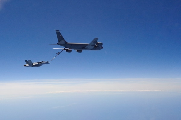 A Canadian Forces CF-18 fighter is refueled by a U.S. KC-135 tanker over Canada Aug. 1, 2016 as part of a coordinated exercise. NORAD and USSTRATCOM conducted intercept and safe passage escort procedures in all three of the NORAD regions to ensure NORAD's rapid response capability.