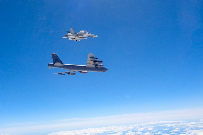 A Canadian Forces CF-18 fighter intercepts a U.S. Strategic Command B-52 bomber over Canada Aug. 1, 2016 as part of a coordinated exercise. NORAD and STRATCOM conducted intercept and safe passage escort procedures in all three of the NORAD regions to ensure NORAD's rapid response capability.