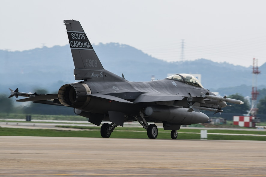 An F-16 Fighting Falcon from the South Carolina Air National Guard's 157th Expeditionary Fighter Squadron taxis on the flightline before takeoff July 27, 2016, at Osan Air Base, Republic of Korea. Approximately 300 Airmen and 12 F-16s from the 169th Fighter Wing deployed to Osan in support of the U.S. Pacific Command Theater Security Package.  (U.S. Air Force photo by Senior Airman Dillian Bamman)
