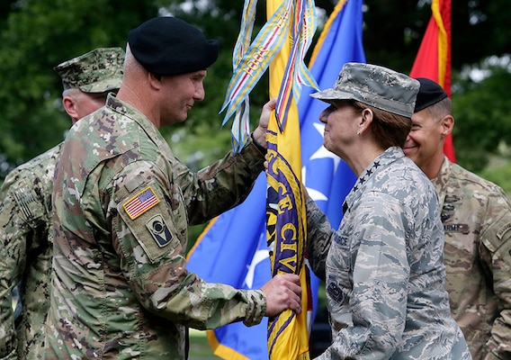 Major General Richard Gallant accepts the flag and command for Joint Task Force Civil Support from General Lori Robinson, NORAD and USNORTHCOM Commander. The change of command ceremony took place at Fort Eustis, Va., July 29, 2016.