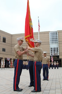 """Major James P. Dollard (right), outgoing commanding officer of Recruiting Station Orange County, Calif., hands the Marine Corps colors to Maj. Michael """"Adam"""" Taylor during the change of command ceremony, July 1, 2016. Taylor is coming from Air Force Command and Staff College in Montgomery, Ala. and Dollard is heading to the Command and Staff College aboard Marine Corps Base Quantico, Virginia.(U.S. Marine Corps photo by Sgt. Vanessa Jimenez)"""