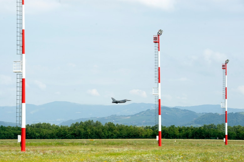 An F-16 Fighting Falcon from the 120th Fighter Squadron, 140th Wing, Colorado Air National Guard, does a low pass fly-by before landing, Cerkjle ob Krki Air Base, Slovenia, 25 July, 2016. The 140th Wing F-16 Fighting Falcons made history when they became the first F-16s to ever land at Cerkjle AB. The 140th WG is currently deployed to Hungary to train with NATO allies in Slovenia, Hungary, Slovakia and the Czech Republic in conjunction with Panther Strike 2016 and Operation Atlantic Resolve. (U.S. Air National Guard photo by Senior Master Sgt. John Rohrer)
