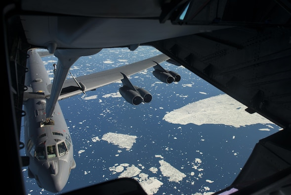 A B-52 Stratofortress from Minot Air Force Base, N.D. receives fuel from a 305th Air Mobility Wing, Joint Base McGuire-Dix-Lakehurst, N.J. during Polar Roar, a strategic deterrence exercise, in the skies near the North Pole, July 31. The B-52 received 70 thousand pounds of fuel from the KC-10 during the refueling.