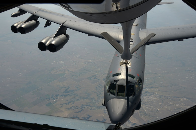 A KC-135 Stratotanker refuels a B-52 Stratofortress, above Minnesota, July 31, 2016. Four of McConnell's KC-135s assisted in refueling two B-52s to reach Polar Roar. Polar Roar is a mission in the Arctic Circle that demonstrates the ability to provide a flexible and vigilant long-range global-strike capability. (U.S. Air Force photo/Airman 1st Class Christopher Thornbury)