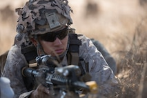 Cpl. Jalen R. Freiberg, a machine gun section leader with 3rd Battalion, 1st Marine Regiment, 1st Marine Division, provides security for Marines inserting into a drop zone during a Marine Corps Readiness Evaluation at Camp Pendleton, Calif., July 28, 2016. The training allows the Marines to work through their standard operating procedures to ensure their methods are effective in a real-life scenario. (U.S. Marine Corps Photo by Lance Cpl. Bradley J. Morrow)