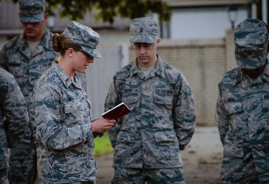 2nd Lt. Chaplain Candidate, Kara Dula reads a morning prayer to the formation of candidates at Robins Air Force Base, Georgia, July 25, 2016. Dula is a participant in the Air Force Reserve Command Chaplain Candidate Intesive Interview program which aims to provide an extensive overview of what the Air Force Reserve mission is as well as a broad overview of the military chaplain corps. During the last week of the AFRC program, the candidates were immersed in fast-paced mobility training conducted by active-duty instructors from the 5th Combat Communications Squadron Support. (U.S. Air Force photo/Tech. Sgt. Kelly Goonan)