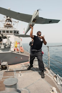 ARABIAN GULF (July 22, 2016)  - Electronics Technician 2nd Class Darius Jackman launches a Puma unmanned aerial vehicle (UAV) from the coastal patrol ship USS Monsoon (PC 4). Monsoon is one of ten coastal patrol ships assigned to Coastal Patrol Squadron (PCRON) 1 home-ported in Manama, Bahrain in support of maritime security operations and theater security cooperation efforts in the U.S. 5th Fleet area of operation.