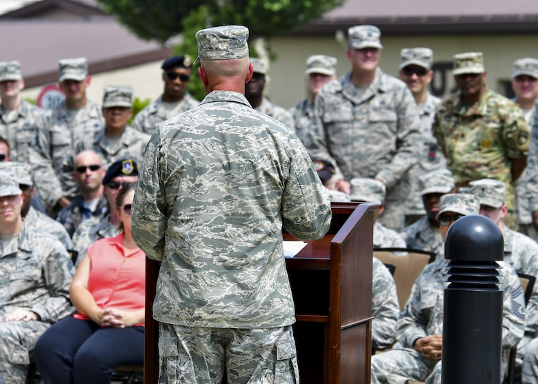 Col. Andrew Hansen, 51st Fighter Wing commander, delivers remarks to the crowd during a re-dedication ceremony at Osan Air Base, Republic of Korea, Aug. 1, 2016. A new statue was erected outside of the base enlisted club in honor of retired Master Sgt. Jim Price, a former Tuskegee Airman who was a part of the Team Osan community for years until his passing in 2008. (U.S. Air Force photo by Senior Airman Victor J. Caputo/Released)