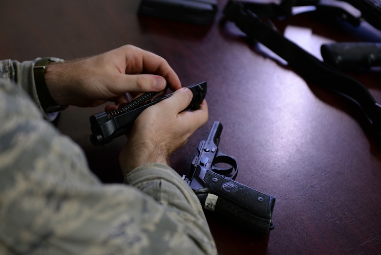 Staff Sgt. Stephen Horton, 36th Security Forces Squadron NCO in charge of resource protection and physical security, assembles an M9 pistol during annual qualification training July 7, 2016, at Andersen Air Force Base, Guam. Prior to firing, students are taught how to handle their weapon, take it apart and conduct preventative maintenance. (U.S. Air Force photo by Airman 1st Class Jacob Skovo)