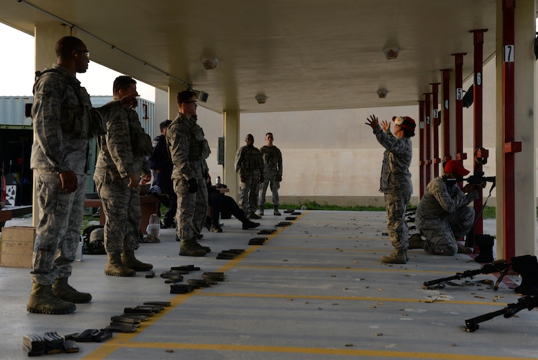 Staff Sgt. Lolita Aguon and Senior Airman William Brown, 36th Security Forces Squadron combat arms instructors, demonstrate firing techniques July 7, 2016, at Andersen Air Force Base, Guam. Weapons qualification is often done in preparation for deployments, for certain permanent changes of station and annually for certain career fields. (U.S. Air Force photo by Airman 1st Class Jacob Skovo)