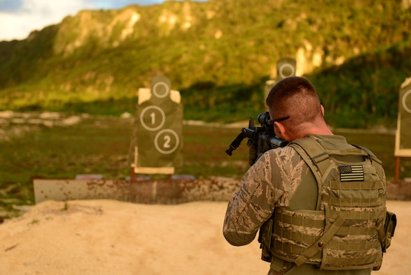 Staff Sgt. Stephen Horton, 36th Security Forces Squadron NCO in charge of resource protection and physical security, fires an M4 carbine at a target July 7, 2016, at Andersen Air Force Base, Guam. Weapons qualification is often done in preparation for deployments, for certain permanent changes of station and annually for certain career fields. (U.S. Air Force photo by Airman 1st Class Jacob Skovo)