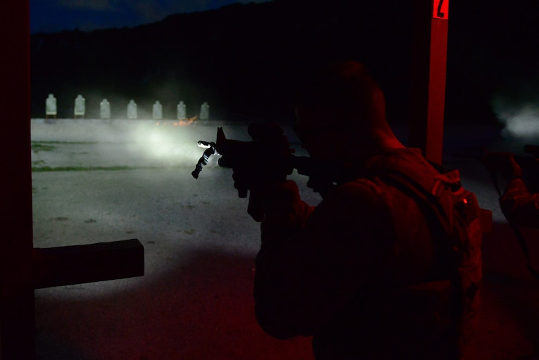 Staff Sgt. Stephen Horton, 36th Security Forces Squadron NCO in charge of resource protection and physical security, fires a M4 carbine while using a mounted flashlight to illuminate his target July 7, 2016, at Andersen Air Force Base, Guam. Training conducted at night consists of using flashlights, night vision sights, lasers and infrared targeting systems. (U.S. Air Force photo by Airman 1st Class Jacob Skovo)