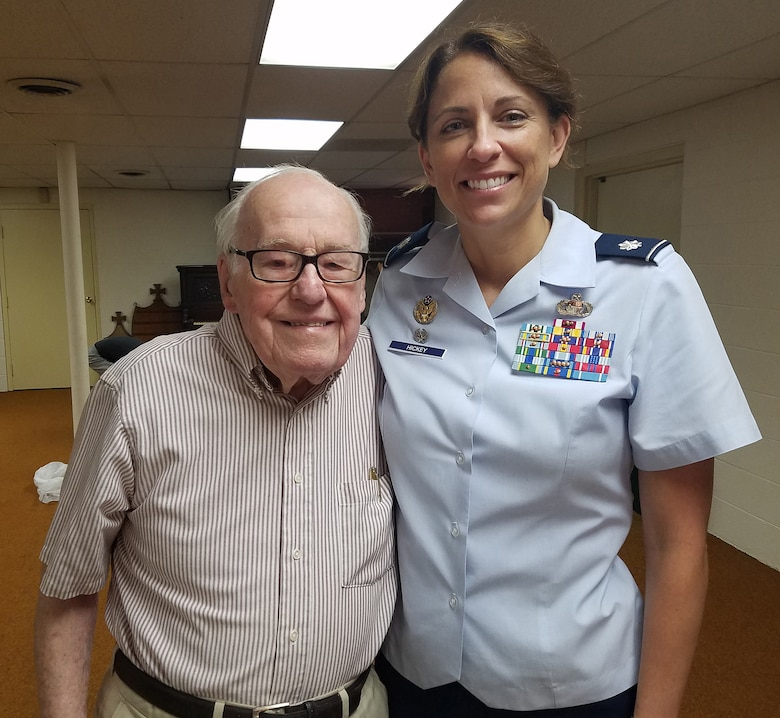 WRIGHT-PATTERSON AIR FORCE BASE, Ohio – Lt. Col. Dianne Hickey, 14th Intelligence Squadron commander, met World War II veteran John Johnson June 15, 2016 after learning about his connection to the 14th IS. Johnson was discovered after two years of historical research by the 14th IS as the unit tried to uncover its lineage. Johnson served in the 9th Photographic Technical Squadron during the time of the atomic strikes on Hiroshima and Nagasaki.  (Courtesy photo)
