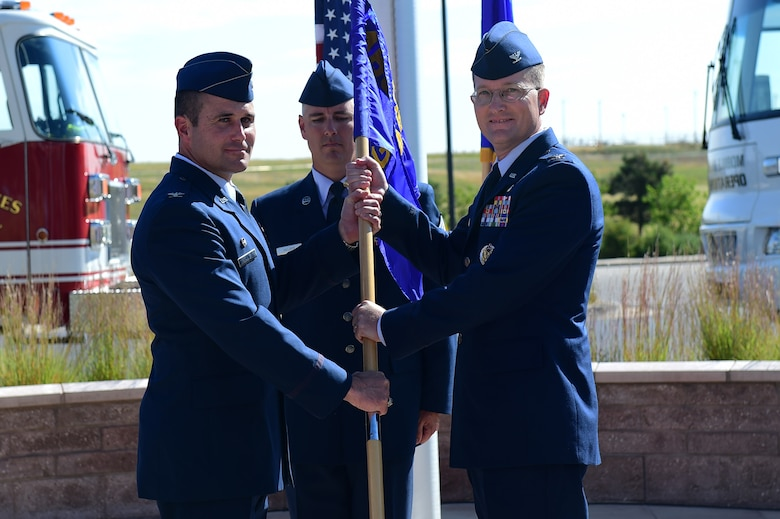 Col. Shawn Thompson, Commander of the 460th Mission Support Group, assumes command August 1, 2016, during the MSG change of command on Buckley Air Force Base, Colo. A change of command ceremony represents the formal transfer of responsibility from an outgoing commander to their successor. (U.S. Air Force photo by Airman 1st Class Gabrielle Spradling/Released)