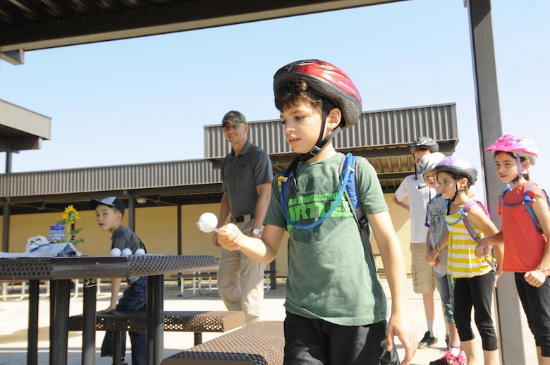 Toby Janaros navigates obstacles while carrying an egg on a spoon during the Amazing gRace: Kids Edition at Schriever Air Force Base, Colorado, Saturday, July 30, 2016. The egg relay was one of eight stations teams had to successfully complete before finishing the scavenger hunt. (U.S. Air Force photo/2nd Lt. Darren Domingo)