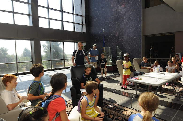 Chaplain (Capt.) Portmann Werner, 50th Space Wing, explains the rules of the race before releasing the teams for the Amazing gRace: Kids Edition at Schriever Air Force Base, Colorado, Saturday, July 30, 2016. Children, aged 7 – 18 years, competed in the event. (U.S. Air Force photo/2nd Lt. Darren Domingo)