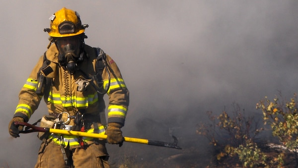 A firefighter from the Albuquerque Fire Department's Wildland Task Force is shown here. DLA Troop Support took over management of 296 wildland fire items from the General Services Administration in May 2014.