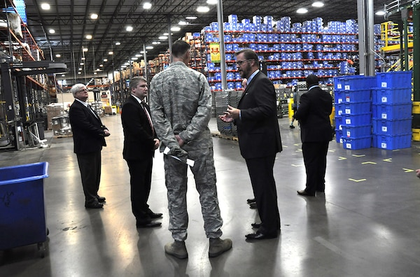 Senior employees of medical supply distributor Owens & Minor, one of DLA's industry partners, conduct a tour of warehouse facilities for DLA Director Air Force Lt. Gen. Andy Busch during a trip to Richmond, Virginia, July 29.