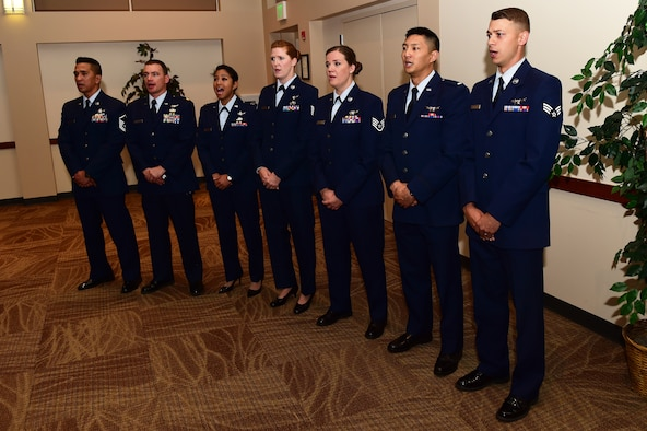 Members of the 2nd Space Warning Squadron and the 8th SWS sing the National Anthem August 2, 2016, during the 460th Operations Group assumption of command ceremony at the Leadership Development Center on Buckley Air Force Base, Colo. The ceremony represents a new commander assuming command of the group and its troops. (U.S. Air Force photo by Airman 1st Class Gabrielle Spradling/Released)