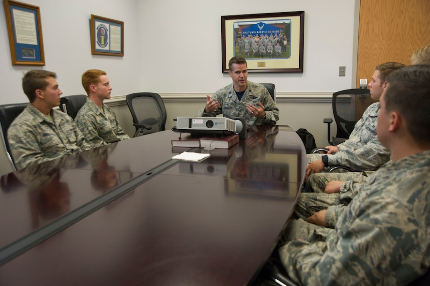 A group of U.S. Air Force Academy cadets speak with Lt. Col. Scott Anderson, Commander of the 89th Operations Support Squadron as they tour the squadron on Joint Base Andrews, Md., as part of the U.S. Air Force Academy's Operations Air Force program. (Photo by U.S. Air Force Senior Master Sgt. Adrian Cadiz)
