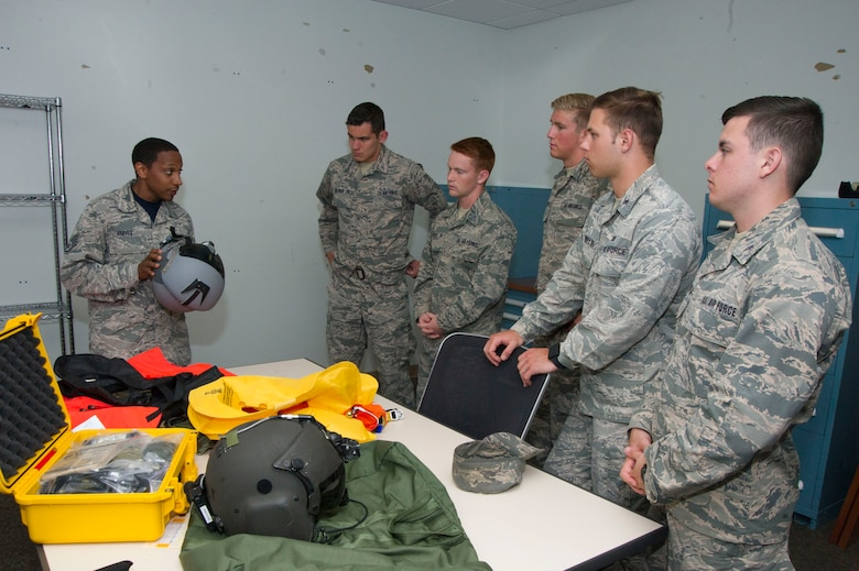 Staff Sgt. Dyral Knott  gives a group of U.S. Air Force Academy cadets a briefing and tour of the Aircrew Flight Equipment section during a tour of the 89th Operations Support Squadron at Joint Base Andrews, Md. The cadets visited the base as part of the U.S. Air Force Academy's Operations Air Force program. (Photo by U.S. Air Force Senior Master Sgt. Adrian Cadiz)