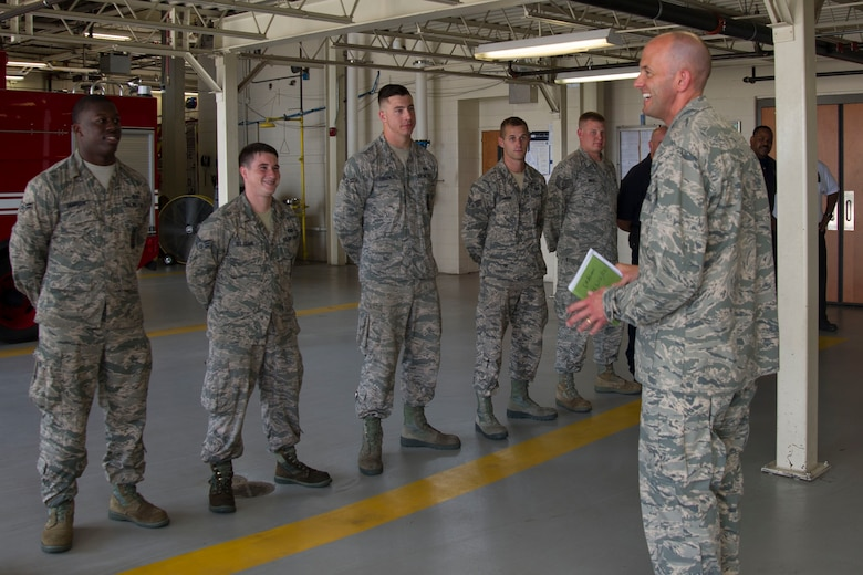 "Col. John Teichert, 11th Wing and Joint Base Andrews commander, addresses members 11th Civil Engineer Squadron at Fire Station One at JBA, Md., Aug. 1, 2016. Teichert visited several of the 11th Mission Support Group squadrons with Chief Master Sgt. Beth Topa, 11th WG command chief master sergeant, to become more familiar with the squadrons' missions and meet with ""America's Airmen."" (U.S. Air Force photo by Airman 1st Class Rustie Kramer)"