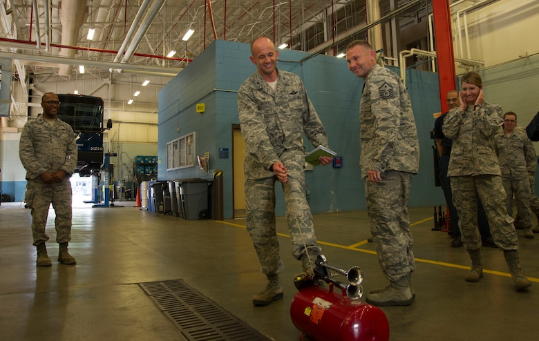 "Col. John Teichert, 11th Wing and Joint Base Andrews commander, sounds an air horn at 11th Logistics Readiness Sqaudron vehicle maintenance bay on JBA, Md., Aug. 16, 2016. Teichert visited several of the 11th Mission Support Group squadrons with Chief Master Sgt. Beth Topa, 11th WG command chief master sergeant, to become more familiar with the squadrons' missions and meet with ""America's Airmen."" (U.S. Air Force photo by Airman 1st Class Rustie Kramer)"