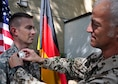 Maj. George Chapman, a former Air Command and Staff College student, receives a German Armed Forces Proficiency Badge from German liaison officer Sgt. Maj. Michael Kern at Maxwell's Air War College, May 4, 2016. (Courtesy photo)