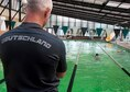 Sgt. Maj. Michael Kern, German liaison officer to Fort Rucker, Alabama, looks on as Air Force, Army, and Navy members complete the swim portion of their German Armed Forces Proficiency Badge qualification at the YMCA in Prattville, Alabama. (Courtesy photo)