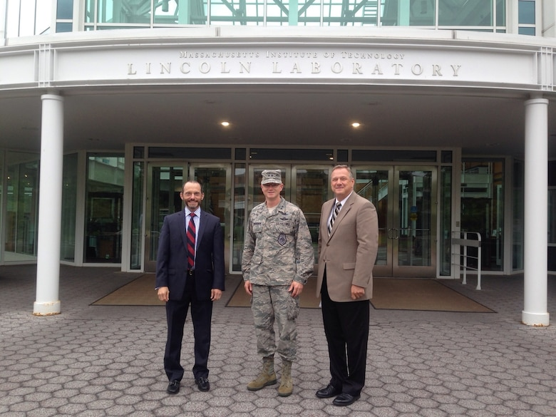 Maj. Gen. Christopher Weggeman, 24th Air Force commander, poses with Mr. Chris Putko (right), Executive Officer, Cyber Security and Communication Systems and Dr. Marc Zissman, Associate Division Head, Cyber Security and Communication Systems at Massachusetts Institute of Technology's (MIT) Lincoln Laboratory, Lexington, Mass. 1 August.  The MIT cyber specialists briefed Weggeman on current research and development efforts related to cyber security, operations, and analytics.