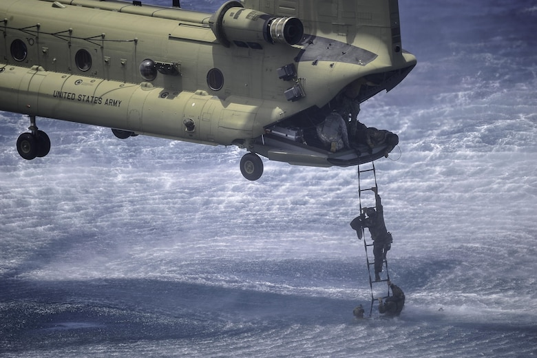 A member of the Belize Coast Guard climbs a Jacobs Ladder to board a CH-47 Chinook assigned to the 1st Battalion, 228th Aviation Regiment during training off the coast of Belize City, July 18, 2016. For many of the BCG participants, this was the first time they were part of helocast and recovery operations. (U.S. Air Force photo by Staff Sgt. Siuta B. Ika)