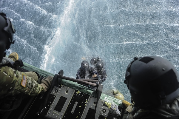 Members of the Belize Coast Guard climb a Jacobs Ladder to board a CH-47 Chinook assigned to Joint Task Force-Bravo's 1st Battalion, 228th Aviation Regiment during training off the coast of Belize City, July 18, 2016. For many of the BCG participants, this was the first time they were part of helocast and recovery operations. (U.S. Air Force photo by Staff Sgt. Siuta B. Ika)