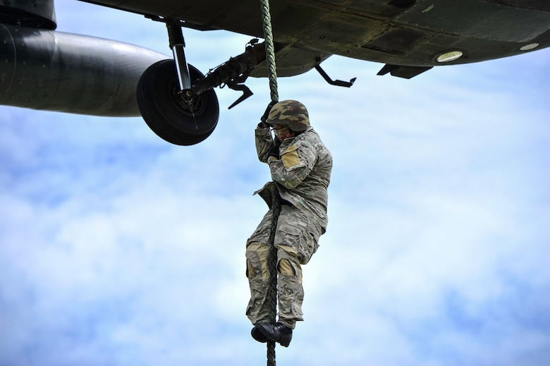A member of the Belize Special Assignment Group fast ropes out of a UH-60 Black Hawk assigned to Joint Task Force-Bravo's 1st Battalion, 228th Aviation Regiment during training at Price Barracks, Belize, July 19, 2016. For many of the BSAG participants, this was their first time they were part of Fast Rope Insertion and Extraction System (FRIES) training. (U.S. Air Force photo by Staff Sgt. Siuta B. Ika)