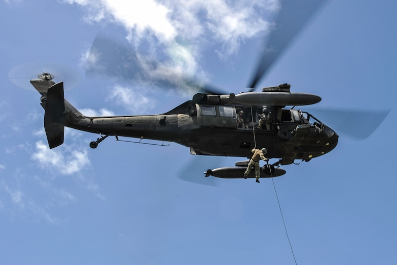 - A member of the Belize Special Assignment Group rappels out of a UH-60 Black Hawk assigned to Joint Task Force-Bravo's 1st Battalion, 228th Aviation Regiment during training at Price Barracks, Belize, July 19, 2016. The 1-228th AVN conducted Fast Rope Insertion and Extraction System (FRIES) training, helocast operations and recovery with the Jacobs Ladder, and open water hoist training with members of the BSAG and Belize Coast Guard. (U.S. Air Force photo by Staff Sgt. Siuta B. Ika)