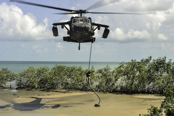 A member of the Belize Special Assignment Group fast ropes out of a UH-60 Black Hawk assigned to Joint Task Force-Bravo's 1st Battalion, 228th Aviation Regiment during training in Belize District, July 21, 2016. The 1-228th AVN conducts aviation operations throughout the U.S. Southern Command area of responsibility. (U.S. Air Force photo by Staff Sgt. Siuta B. Ika)