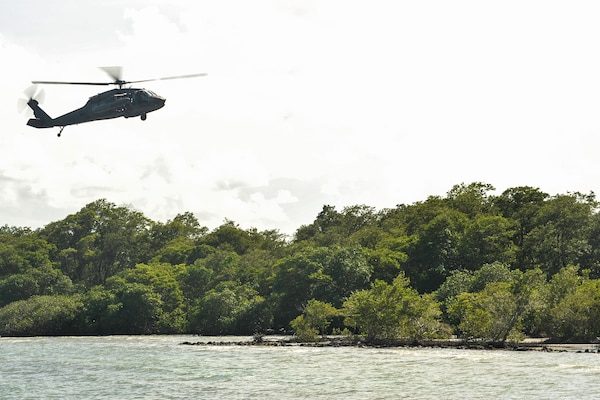 A UH-60 Black Hawk assigned to Joint Task Force-Bravo's 1st Battalion, 228th Aviation Regiment approaches an extraction point during training in Belize District, July 21, 2016. As the only forward deployed aviation assets in the U.S. Southern Command theater, the 1-228th AVN facilitates USSOUTHCOM's Theater Engagement Strategy that includes building partner nation capacity to conduct counter-transnational organized crime operations. (U.S. Air Force photo by Staff Sgt. Siuta B. Ika)